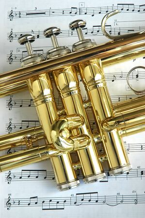 brassy: Trumpet on musical notes as background