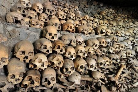 Skulls and bones in a cave photo