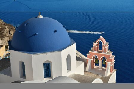 Blue domed church in Oia Village, Santorini, Greece. Stock Photo