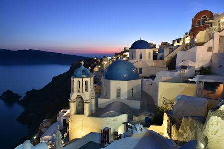 Famous blue dome churches in Oia Village, Santorini, Greece