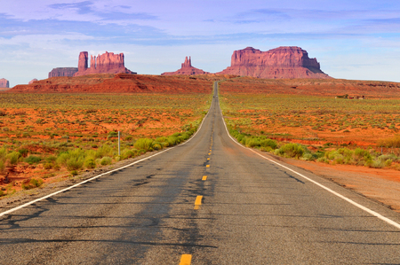 The famous highway in Monument Valley Tribal Park in Utah-Arizona border, USA Banco de Imagens