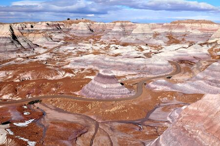 1.1 miles Blue Mesa hiking trail winds through stunning badlands formation at Petrified Forest National Park in North East Arizona USA. Stock Photo