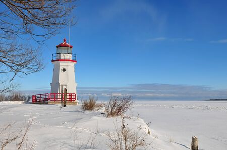 Cheboygan Crib Light is a light that marks the west pier head of the mouth of the Cheboygan River into Lake Huron in Cheboygan, Michigan, USA. Stock Photo