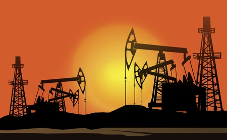petroleum blue: oil derrick in the sunset background