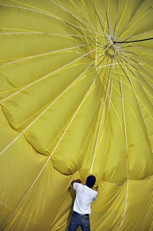 man with yellow hot balloon Stock Photo - 13246236