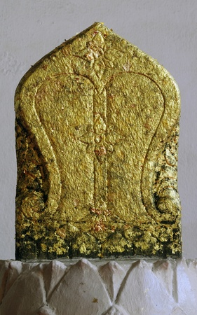 Gold leaf on the old Thai stone boundary marker Stock Photo - 13310279