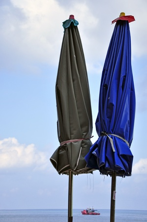 Folded umbrella on on blue sky photo