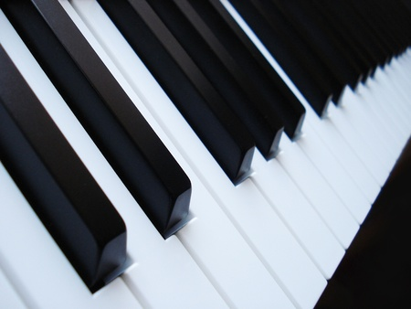 art lessons: A close up image of black and white piano keys. Digital keyboard. Stock Photo