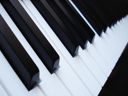 melodious: A close up image of black and white piano keys. Digital keyboard. Stock Photo