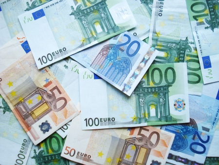 a lot of money: Euro banknotes scattered by chance on a table.