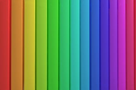 Colorful panels background with plastic surfaces lined up with the rainbow colors.