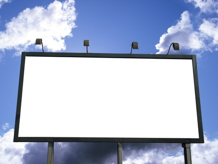 Blank outdoor billboard for advertising on blue sky with clouds. White empty space for your text or copy. photo