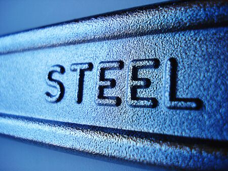steely: Close-up of steel sign on industrial forged wrench.