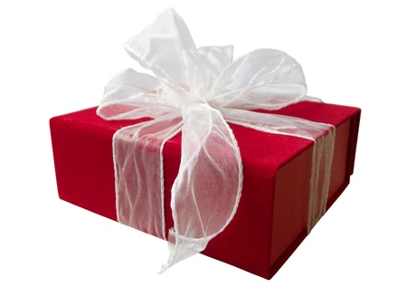 Present in a red gift box with white tulle ribbon. Isolated on white background. Stock Photo - 11694897