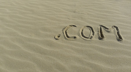 Web and internet concept with  com sign on the sea shore  photo