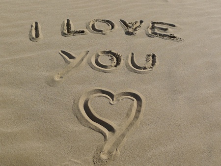 anniversary beach: Summer love concept with I love you sign and heart shape on the beach  Stock Photo