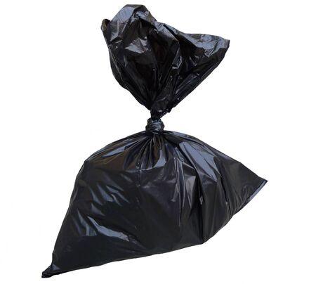 Black garbage bag isolated on white background  photo