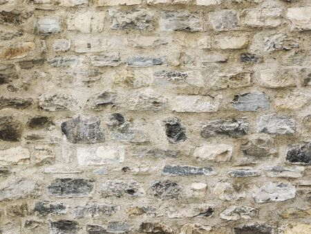 Grunge stlye  Wall background or texture with irregular size and shape of stones  Stock Photo - 14386479