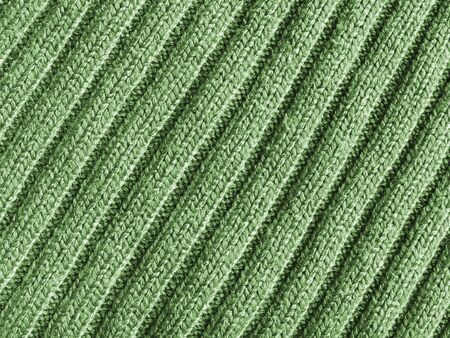 furrows: Close-up view of wool fabric pattern colored in green