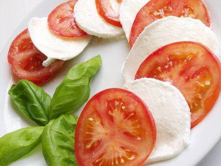 Italian cuisine  A delicious closeup of caprese salad summer dish made with fresh tomato, mozzarella and basil  photo