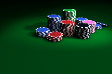 Gambling casino chips stacked on green table  Great background for poker magazines, banners, webpages, flyers, etc  photo