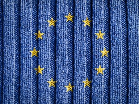 european economic community: Close-up view of wool fabric pattern with the flag and emblem of Europe  European Union background