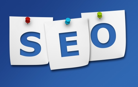 Website optimization and Internet search engine concept with SEO word on three paper post it on blue background  Stock Photo - 19090004