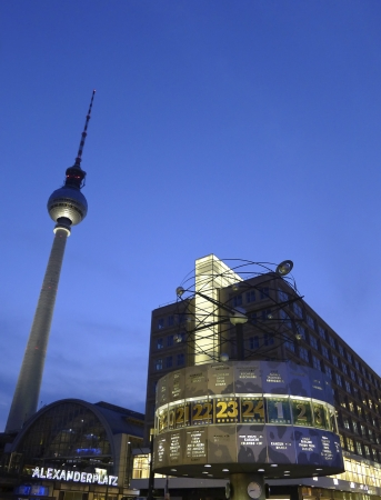 View of Berlin Alexanderplatz at sunset with the tv tower and the World clock in the central Mitte district of Berlin, Germany, Europe