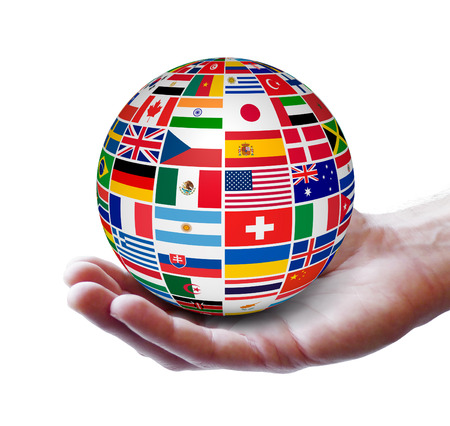 Travel, services and international business concept with a globe and international flags of the world on a man hand  Isolated on white background  photo