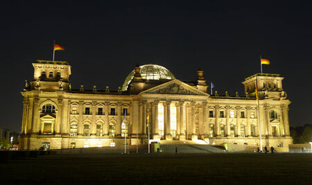 election night: Frontal night view of Reichstag building Bundestag in Berlin, Germany, Europe