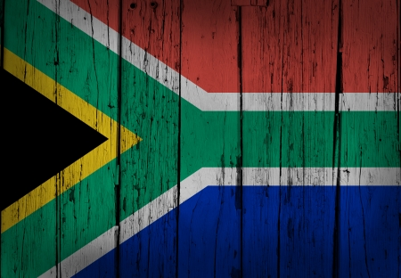 painted wood: South Africa grunge wood background with flag painted on aged wooden wall  Stock Photo