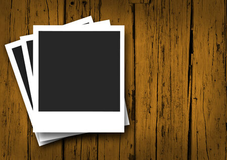 snapshot: Vintage concept with blank photo frames with shadow and empty space for your photograph and picture on wooden grunge brown background