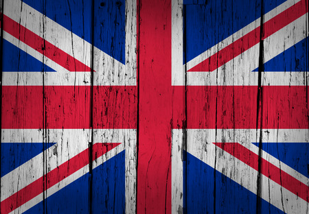United Kingdom grunge wood background with British flag painted on aged wooden wall  photo