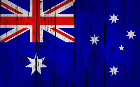 Australia grunge wood background with Australian flag painted on aged wooden wall  photo