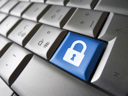 Internet, web and computer data security concept with padlock icon and symbol on a blue laptop key for website and online business. photo