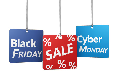 Black Friday and Cyber ??Monday shopping concept with sale sign and percent symbol on hanged tags isolated on white background.