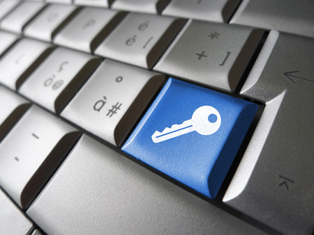 Access key Internet security concept with key icon and symbol on a blue laptop computer key for website, blog and online business. photo