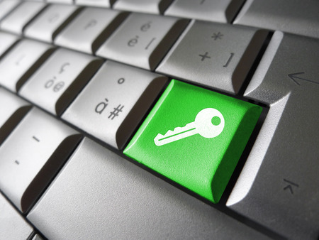 Access key Internet security concept with key icon and symbol on a green laptop computer key for website, blog and on line business. photo