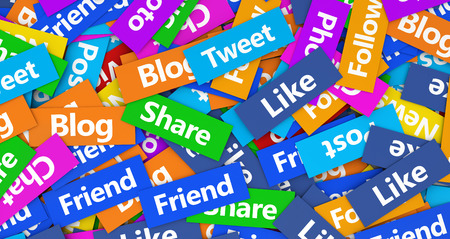 Social network, web and Internet concept background with a multitude of social media words, sign and text on colorful scattered paper. photo