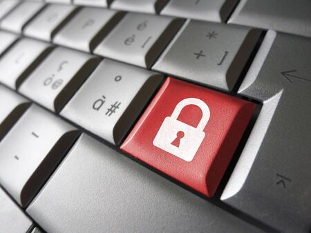 Internet, web and computer data security concept with padlock icon and symbol on a red laptop key for website and online business. photo