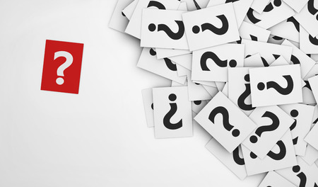 Business questions concept with a question mark symbol on a red paper and a multitude of question marks signs on scattered white papers.