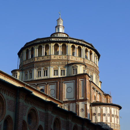 leonardo da vinci: Dome view of Milan church Holy Mary Of Grace famous for the mural of The Last Supper by Leonardo Da Vinci with a beautiful blue sky.