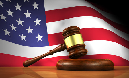 constitutional: American law and justice concept with a 3d rendering of a gavel on a wooden desktop and the United States Of America flag on background.