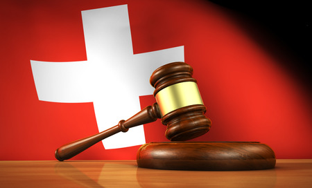 lawer: Swiss law and justice concept with a 3d rendering of a gavel on a wooden desktop and the Switzerland flag on background.