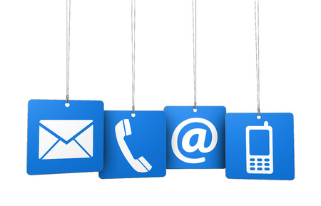 email us: Web contact us Internet concept with email, mobile phone and at icon and symbol on four blue hanged tags for website, blog and on line business. Stock Photo