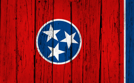 Tennessee grunge wood background with Tennessean State flag painted on aged wooden wall.