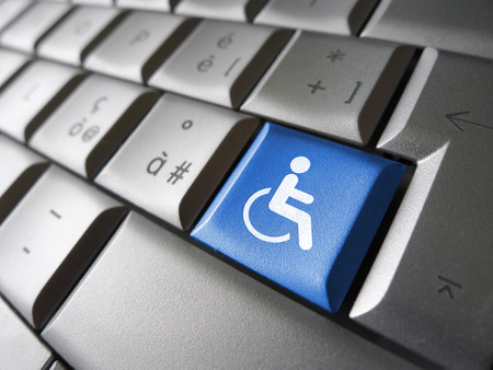keyboard key: Web content accessibility concept with wheelchair icon and symbol on a blue computer key for blog and online business.