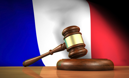 constitutional law: Law and justice in France concept with a 3d rendering of a gavel on a wooden desktop and the French flag on background.