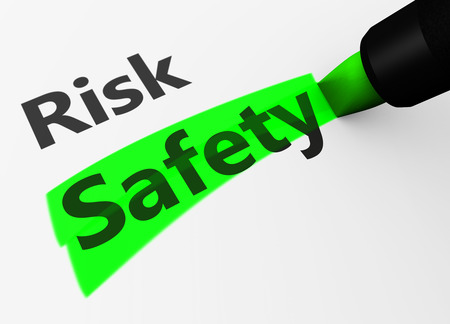 safety first: Safety and security concept with a 3d rendering of risk text and safety word highlighted with a green marker. Stock Photo
