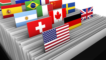 International business and global market concept with a close-up of a customer file directory with document and some international flags on tags.